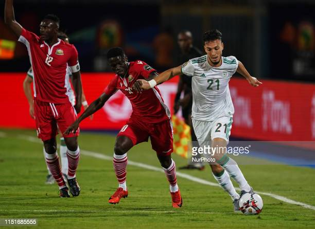 Amir Selmane Rami Bensebaini of Algeria and Eric Johana omondi of Kenya challenging for the ball during the 2019 African Cup of Nations match between...