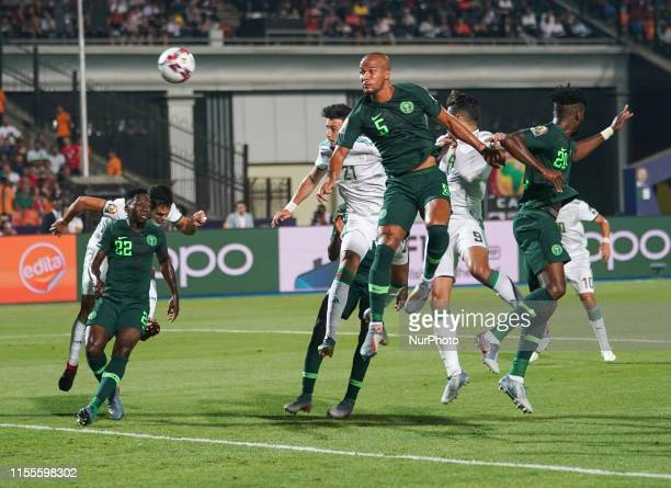 Amir Selmane Rami Bensebaini of Algeria heading on goal during the 2019 African Cup of Nations match between Algeria and Nigeria at the Cairo...