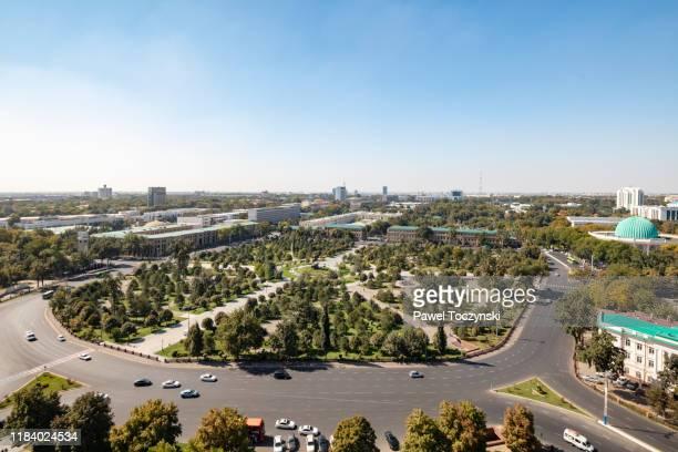 amir temur square from the famous soviet-built hotel uzbekistan in central tashkent, uzbekistan - dictator stock pictures, royalty-free photos & images