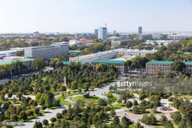 amir temur square from the famous soviet-built hotel uzbekistan in central tashkent, uzbekistan - kapitell stock-fotos und bilder