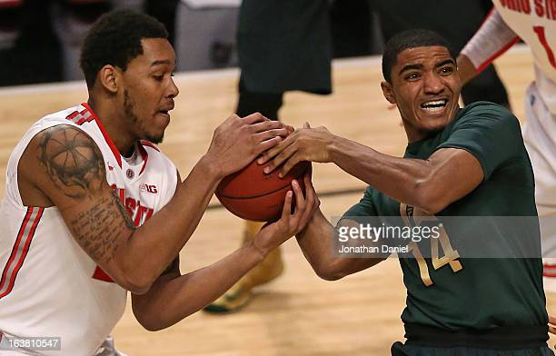 Amir Williams of the Ohio State Buckeyes battles for possession of the ball with Gary Harris of the Michigan State Spartans during a semifinal game...