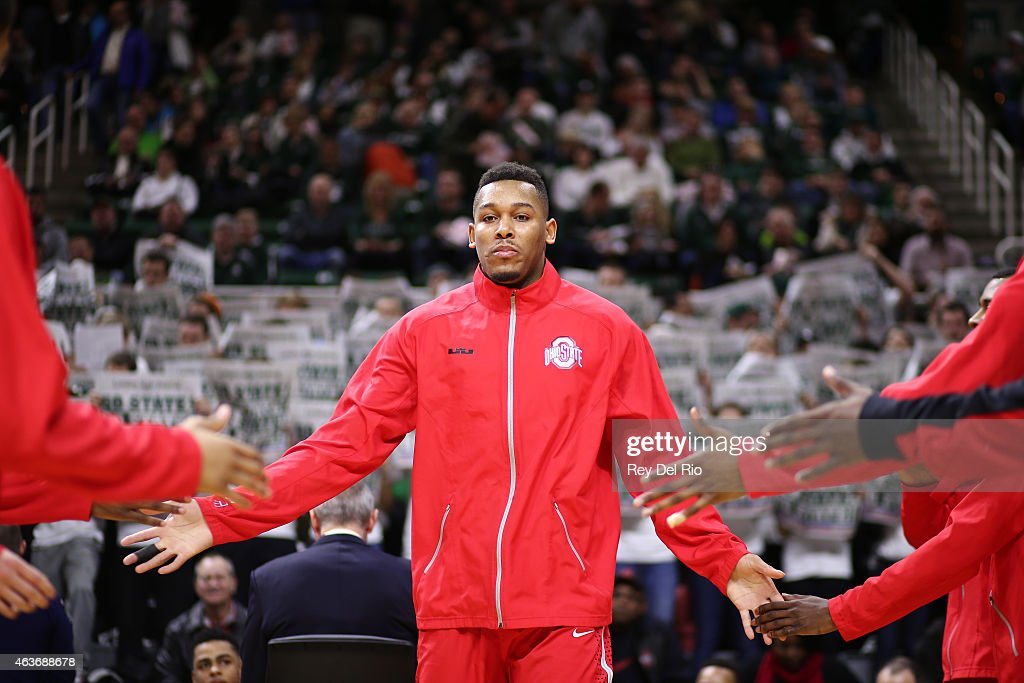 Amir Williams #23 of the Ohio State Buckeyes during staring line prior to the start of the game against the Michigan State Spartans at the Breslin Center on February 14, 2015 in East Lansing, Michigan.
