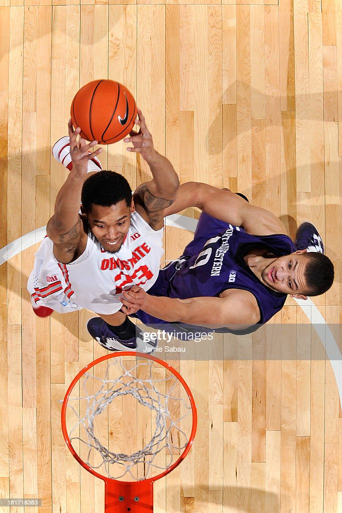 Amir Williams #23 of the Ohio State Buckeyes goes up for shot in the first half as Mike Turner #10 of the Northwestern Wildcats defends on February 14, 2013 at Value City Arena in Columbus, Ohio. Ohio State defeated Northwestern 69-59.