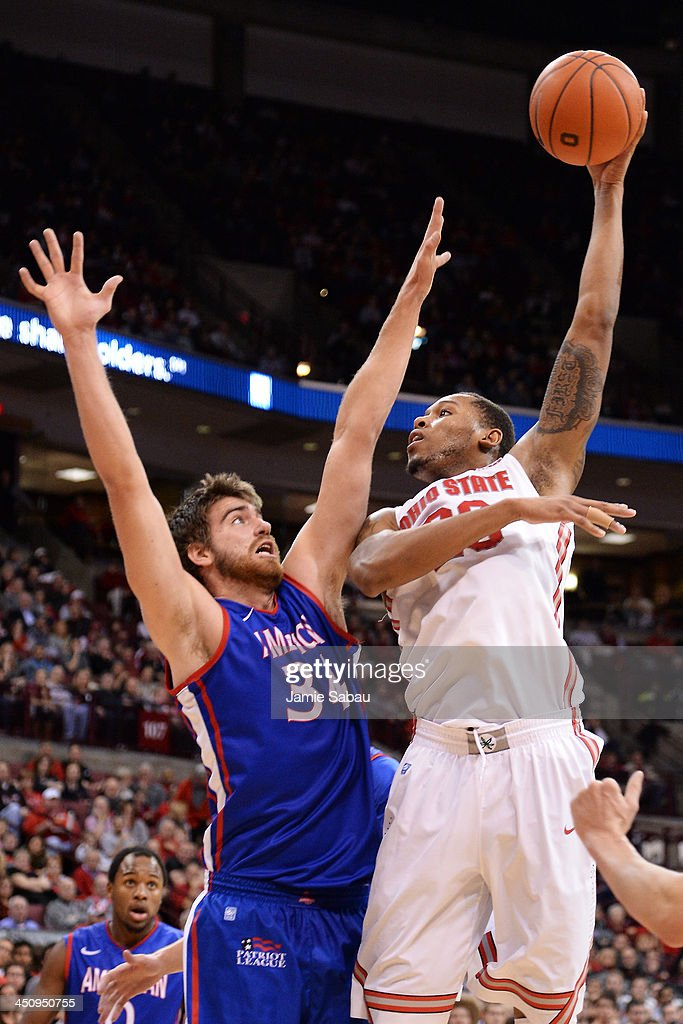 Amir Williams #23 of the Ohio State Buckeyes hooks in two point over Tony Wroblicky #34 of the American University Eagles in the second half on November 20, 2013 at Value City Arena in Columbus, Ohio. Ohio State defeated American 63-52.