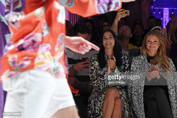 Amira Aly and Jana Julie Kilka react to Oliver Pocher performing at the Sportalm Kitzbuehel show during the Berlin Fashion Week Spring/Summer 2020 at...