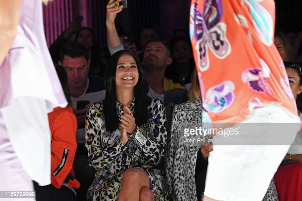 Amira Aly reacts to Oliver Pocher performing at the Sportalm Kitzbuehel show during the Berlin Fashion Week Spring/Summer 2020 at ewerk on July 03...