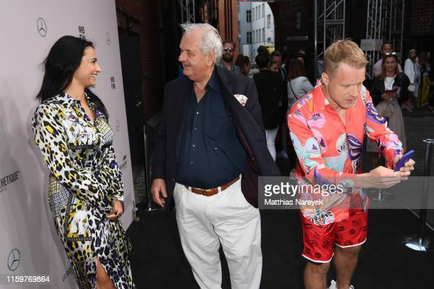 Amira Aly Wilhelm Ehrlich and Oliver Pocher attend the Sportalm Kitzbuehel show during the Berlin Fashion Week Spring/Summer 2020 at ewerk on July 03...