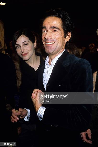 Amira Casar and Vincent Darre during Paris Fashion Week Ready To Wear Fall/Winter 2005 Ungaro Show at Front Row Carrousel Du Louvre in Paris France