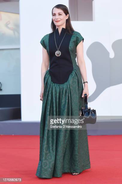 """Amira Casar walks the red carpet ahead of the movie """"Amants"""" at the 77th Venice Film Festival at on September 03, 2020 in Venice, Italy."""