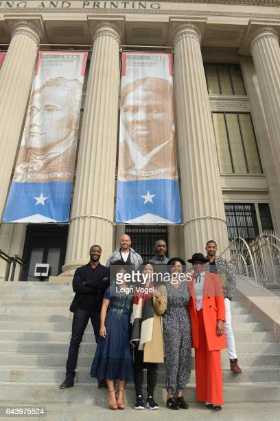 Amirah Vann Jurnee SmolletBell Misha Green and Aisha Hinds Aldis Hodge Anthony Hemingway Mike Jackson and Alano Miller stand in front of a banner...