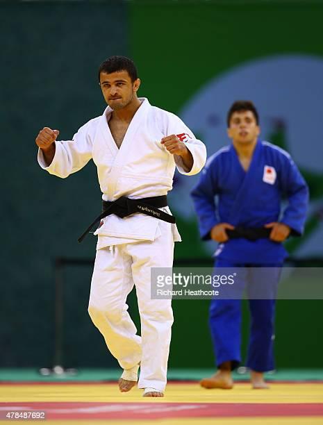 Amiran Papinashvili of Georgia celebrates victory over Francisco Garrigos of Spain in the Men's Judo -60kg Bronze Final during day thirteen of the...
