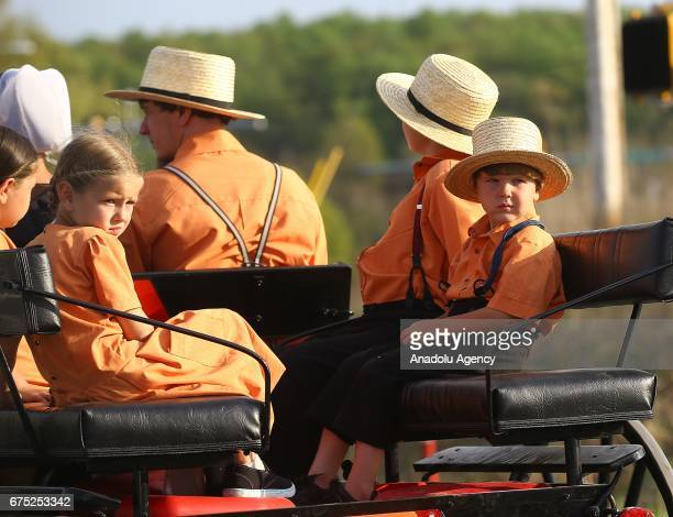 Amish children are seen on an amish horse in Central Pennsylvania United States on April 30 2017 Central Pennsylvania is home to an iconic set of...