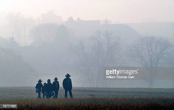 Amish children head to school April 2, 2007 in Nickel Mines, Pennsylvania. The school opened six months from the day, October 2 that ten of their...