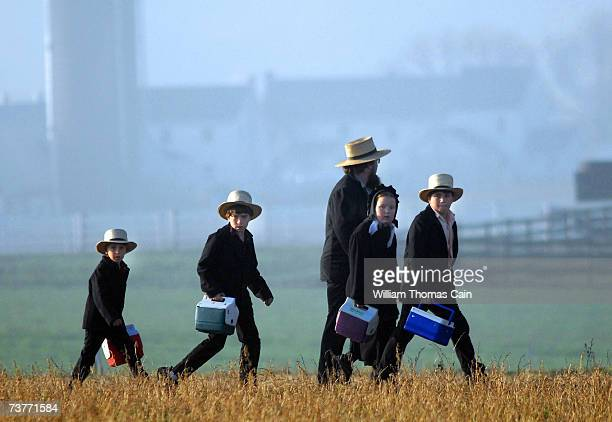 Amish children head to their newly built schoolhouse April 2 2007 in Nickel Mines Pennsylvania The school opened six months from the day October 2...
