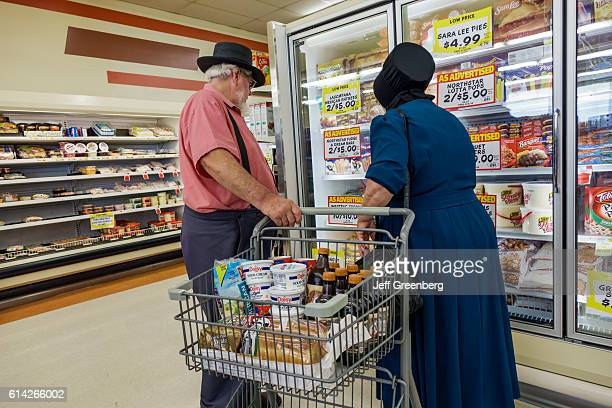 Amish couple inside IGA Foodliner grocery store