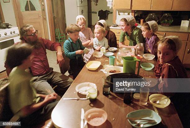 Amish Family Around the Kitchen Table