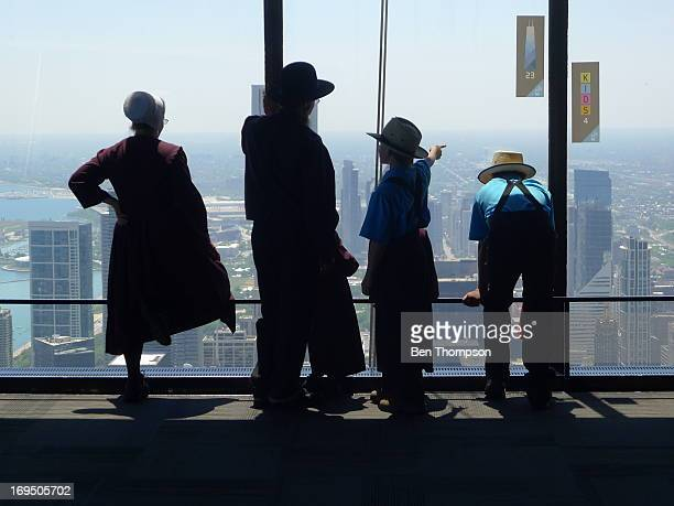 CONTENT] Amish family visits the Hancock Tower observation deck in Chicago