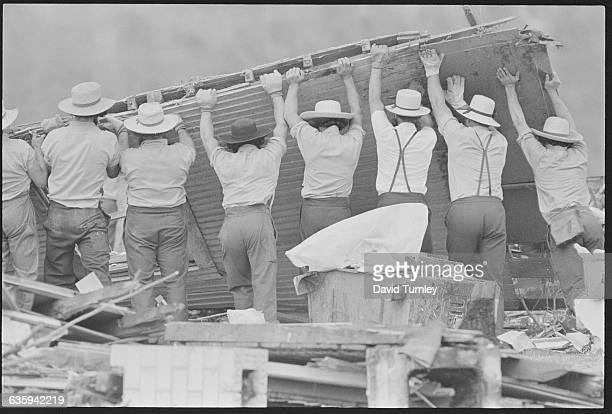 Amish Men Lifting Rubble