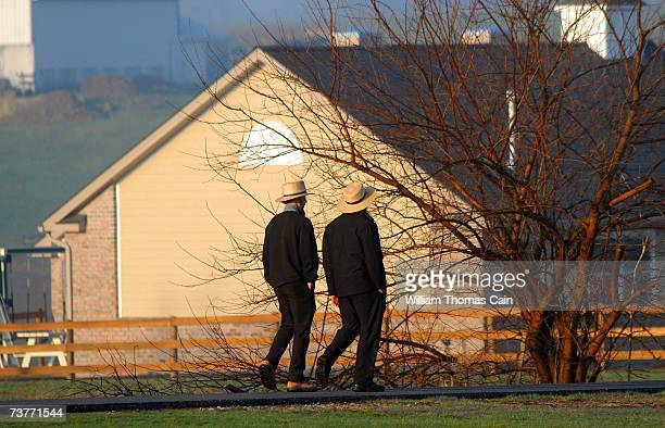 Amish men pass the newly built schoolhouse April 2 2007 in Nickel Mines Pennsylvania The school opened six months from the day October 2 that ten of...