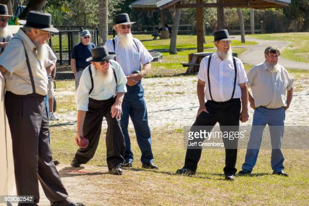 Amish men playing a game of bocce ball at Pinecraft Park
