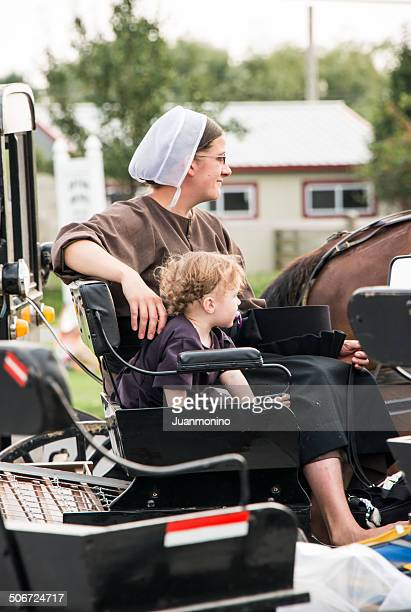 amish mother - amish woman stock pictures, royalty-free photos & images