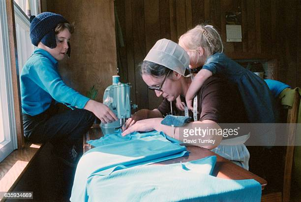 Amish Mother Sewing