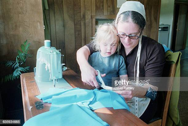 Amish Mother Sewing With Her Daughter