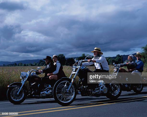 amish on motorcycles - amish woman stock pictures, royalty-free photos & images