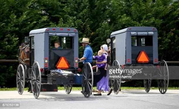 Amish people are seen next to an amish horse in Central Pennsylvania United States on April 30 2017 Central Pennsylvania is home to an iconic set of...