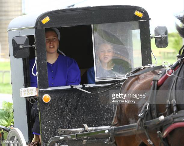 Amish women ride an amish horse in Central Pennsylvania United States on April 30 2017 Central Pennsylvania is home to an iconic set of plain people...