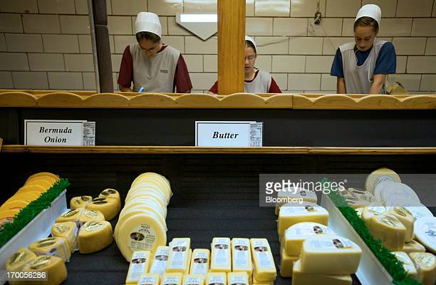 Amish women work in the retail area at Heini's Cheese production facility in Berlin Ohio US on Thursday June 6 2013 The US Census Bureau is scheduled...