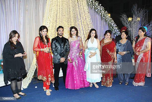 Amisha Patel Kiran Bawa and Raveena Tandon with the newly wed couple at Banpreet Singh Atal and Sahiba's wedding reception at ITC Grand Maratha...