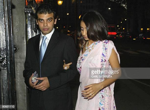 Amit Bhatia and Vanisha Mittal daughter of Multimillionaire Steel businessman Laxmi Mittal arrive at Annabels nightclub in London 05 June 2004 for...