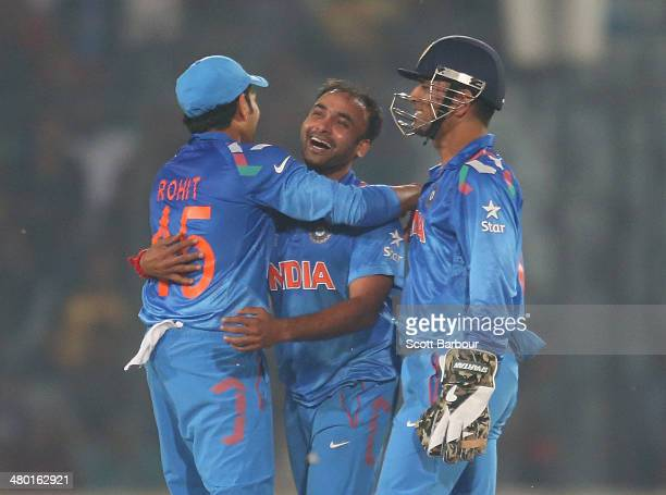 Amit Mishra celebrates after dismissing Marlon Samuels of the West Indies during the ICC World Twenty20 Bangladesh 2014 match between the West Indies...