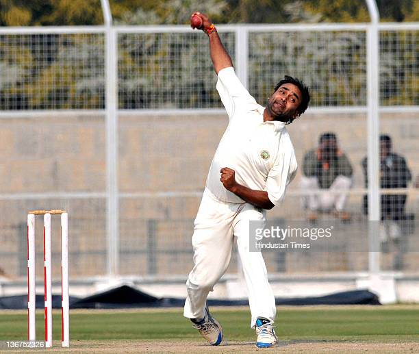 Amit Mishra of Haryana bowls during the second day of the Ranji semi final match between Rajasthan and Haryana on January 11 2012 in Rohtak India...