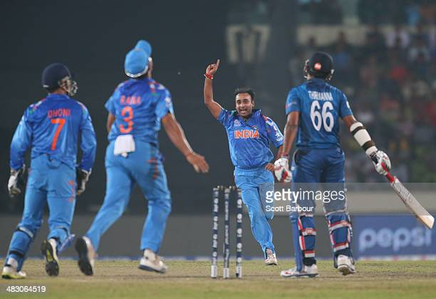 Amit Mishra of India celebrates after dismissing Lahiru Thirimanne of Sri Lanka during the Final of the ICC World Twenty20 Bangladesh 2014 between...