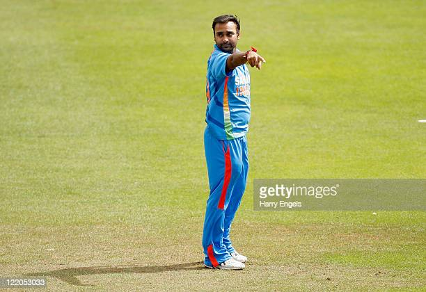 Amit Mishra of India gestures to his fielders during the one day tour match between Sussex and India at The County Ground on August 25 2011 in Hove...