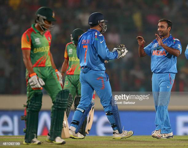 Amit Mishra of India is congratulated by his teammates after dismissing Anamul Haque of Bangladesh during the ICC World Twenty20 Bangladesh 2014...