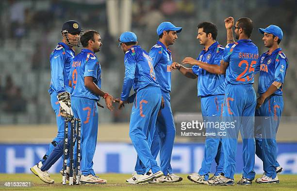 Amit Mishra of India is congratulated on the wicket of Brad Hodge of Australia after Ravindra Jadeja caught him during the ICC World Twenty20...
