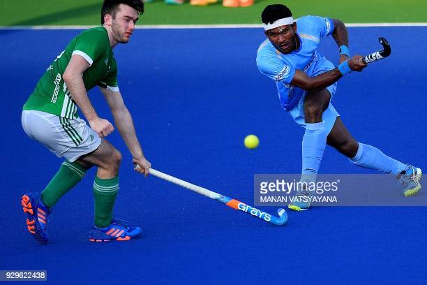 Amit Rohidas of India vies for the ball with Ireland's John Mckee during their men's field hockey match of the 2018 Sultan Azlan Shah tournament at...