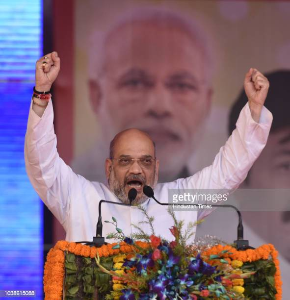Amit Shah BJP national President being facilitated during the 'Purvanchal Mahakkumbh' Rally at Ramlila Ground on September 23 2018 in New Delhi India