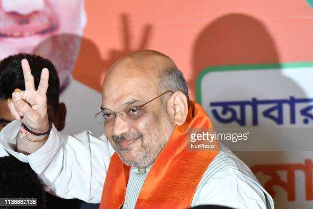Amit Shah National President of BJP showing victory Singh a press conference on April 222019 in KolkataIndia