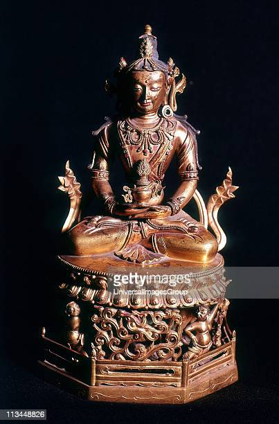 Amitaba Buddha in his manifestation of Boundless Life sitting holding a vessel containing the nectar of immortality Tibetan Art Bronze 18th century
