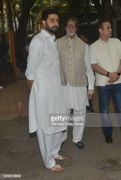 Amitabh Bachchan and Abhishek Bachchan at the funeral of Krishna Raj Kapoor wife of Lt Raj Kapoor in Mumbai