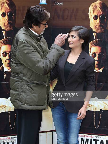 Amitabh Bachchan and Akshara Haasan attends a photocall for Shamitabh at St James Court Hotel on January 27 2015 in London England