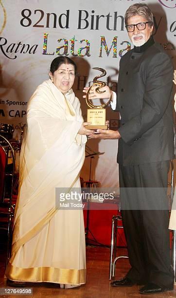 Amitabh Bachchan and Lata Mangeshkar at veteran singer Lata Mangeshkar's birthday concert in Mumbai on Wednesday night