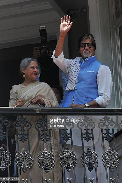 Amitabh Bachchan and wife Jaya wave to their fans from the balcony during the Kalyan Jewelle's new showroom inauguration ceremony in Kolkata India on...