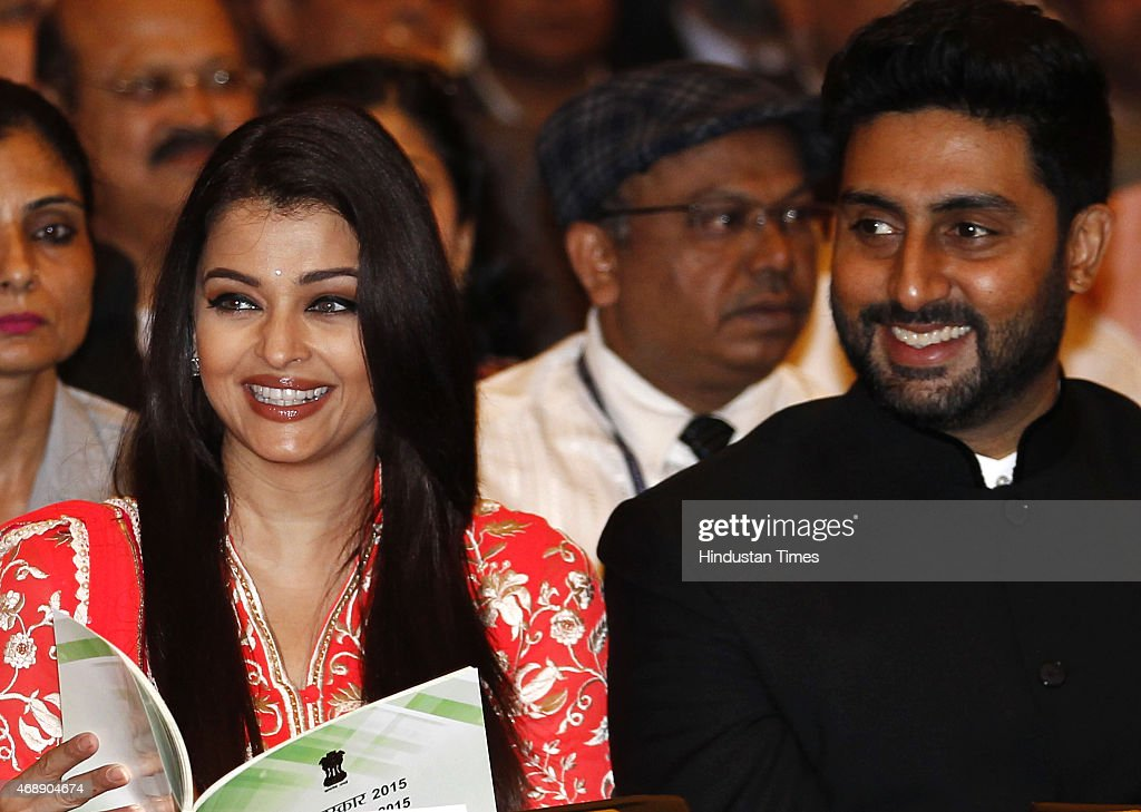 Amitabh Bachchans son Abhishek Bachchan and daughterinlaw Aishwarya Rai Bachchan during a civil investiture ceremony where Amitabh Bachchan received..