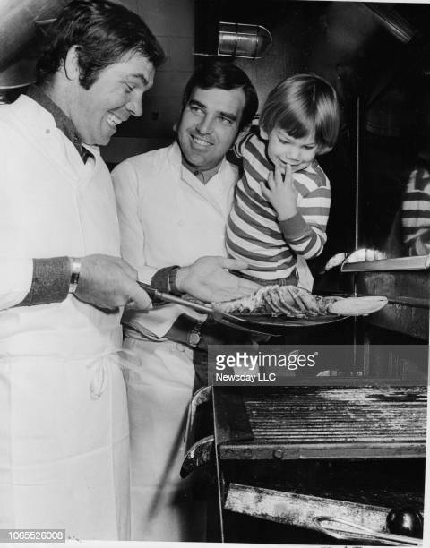 Mets Ed Kranepool and Yankees Ron Swoboda cook up a lobster to the delight of Kranepool's son at the restaurant the former teammates coown The Dugout...