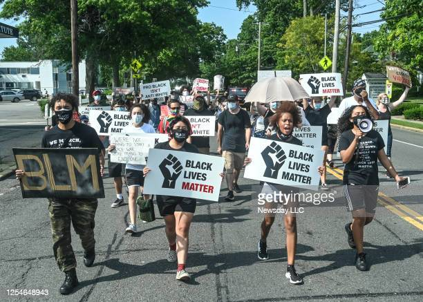 Protestors march against racism and police brutality on Broadway in Amityville New York on on July 5 2020